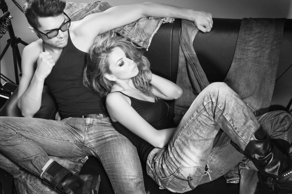 Sexy man and woman dressed in jeans doing a fashion photo shoot